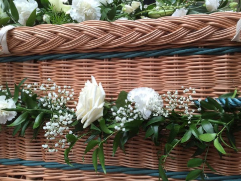 Wicker eco coffin with flower